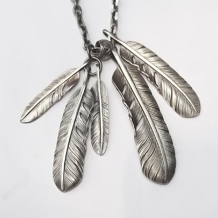Silver feather pendant native american inspired silver for Native american feather jewelry