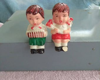 Vintage Boy and Girl Sitting Salt N Pepper Shakers