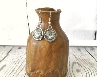 Ornate silver earrings with ash grey mandala patterned bead.