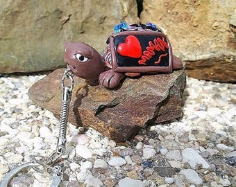 "Keychain turtle Brown ""I love you MOM"" is made of polymer clay."