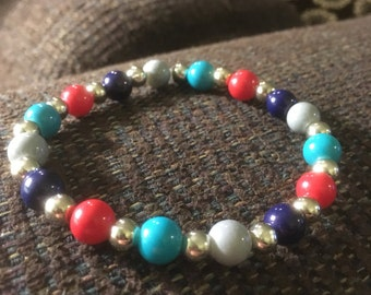 Red, blue and gray beaded bracelet