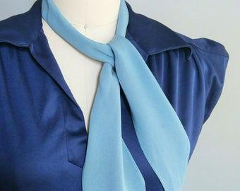 sky / blue neck tie / ascot tie