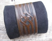 Mens Leather Cuff Bracelet with Hand Tooled tribal Viking design custom made to order. Free shipping.