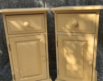 A pair of bedside cabinets painted in 'mustard', gently distressed to reveal a little 'old white' underneath.