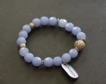 """Faceted periwinkle bead bracelet with """"inspire' charm"""
