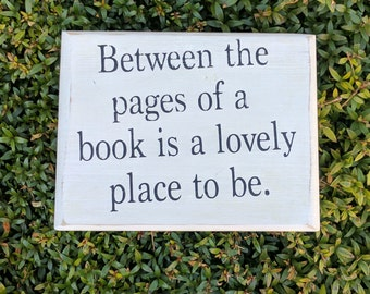 Between the pages of a book is a lovely place to be - mini wood sign