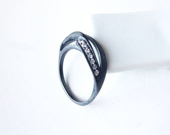 Escher-07: infinite black oxidized sterling silver ring and white zircons.
