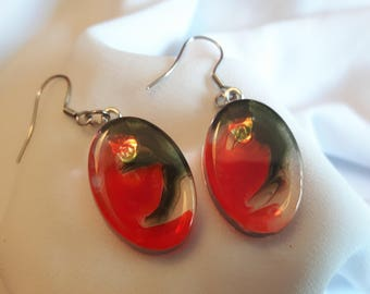 Transparent red and black resin oval earrings