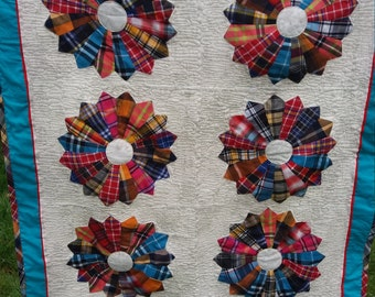 Bright and cheerful throw quilt with Tartan style checks