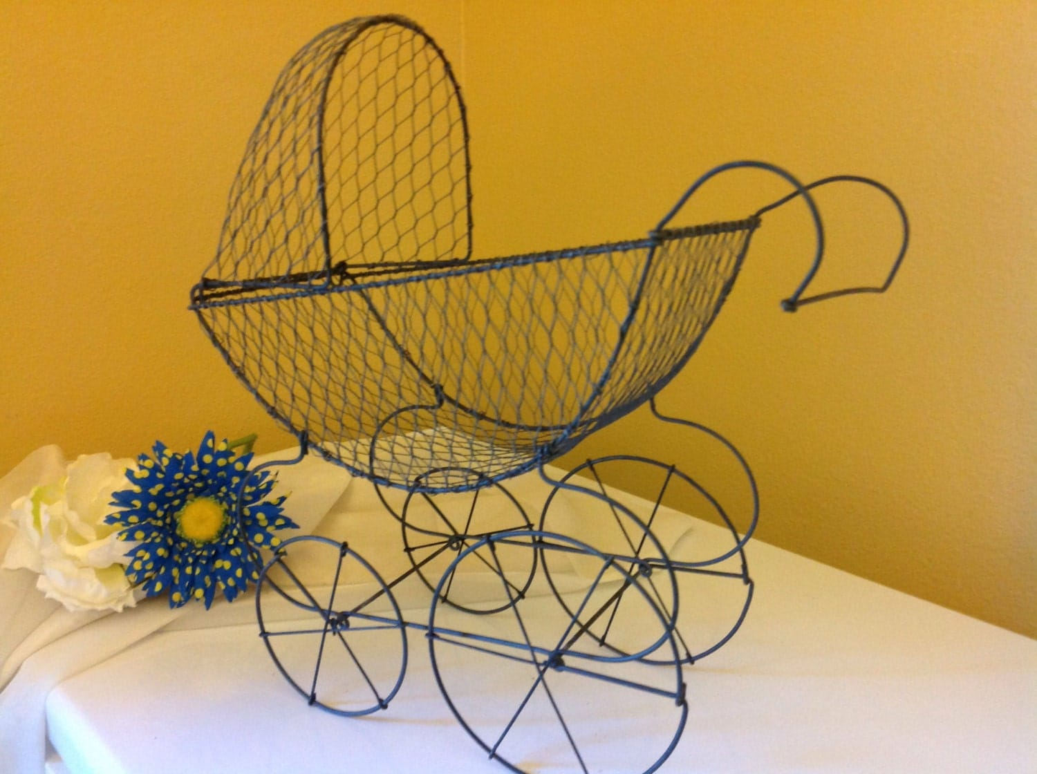 Wire baby carriage centerpiece antique baby carriage baby for Baby carriage decoration