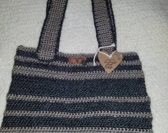 "Crochet bag gray and taupe with little inspirational token that says""Lucky"".For everyday,books or small laptop."