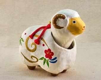 Bobble head toy sheep. Nodder doll, Japanese folk toy.