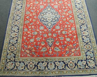 Rug from Iran completely hands very pretty colors, made in the late 1980s size 204x140cm.