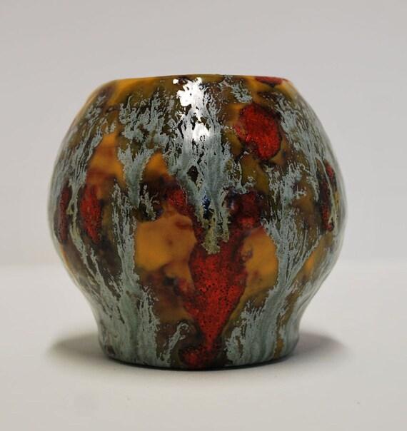 Beautiful hand made multi coloured ceramic vase with sheen finish. Dark brown interior / Vase en céramique