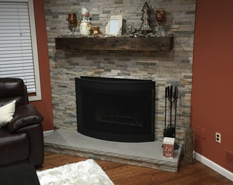 Distressed wood fireplace mantle