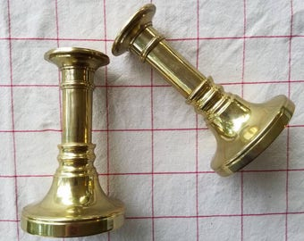Set of two vintage solid brass candle holders
