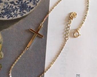 14k yellow gold sideway cross bracelet