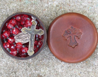 Hand made leather rosary box with felt lining.