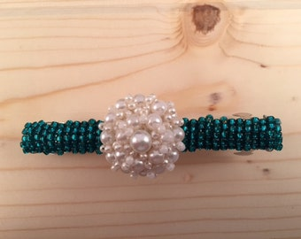 Turquoise beaded barretts with large center white button.