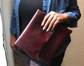 Red faux leather fold over clutch