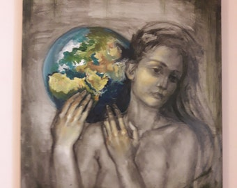 World on womans shoulders