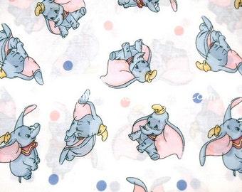 xf001 - 1 Yard Lightweight Cotton Fabric - Cartoon Characters, Dumbo and Dots - White (W140)