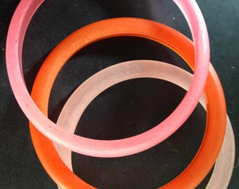 Resin Bangles in a variety of colours, Orange and Pink