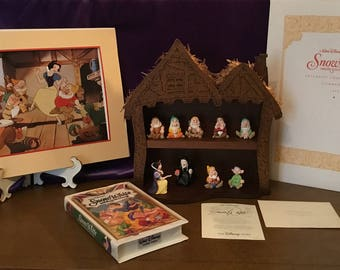 Collectible Snow White and seven dwarves thimble set with lithograph and movie