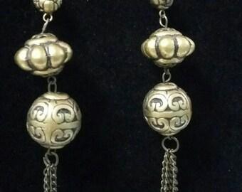 Long Brass color tassel earrings