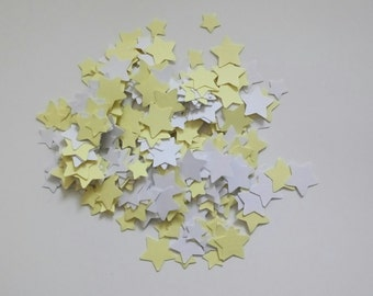 Handmade star shaped table confetti in yellow and white