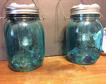 Light blue hanging mason jar solar lamps!