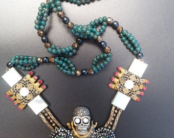 Skull necklace,1040 s brass stamping s,mother of pearl,three strand bead work,hand made one off.