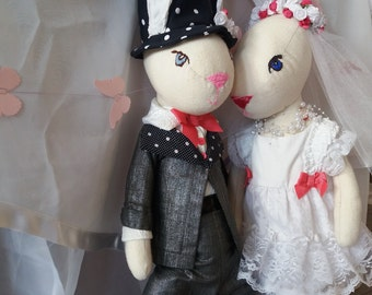 Couple of Bunnies in love. Handmade Bunnies are getting married. These dolls can be a wonderful wedding presen.Gift for the Valentine's Day.