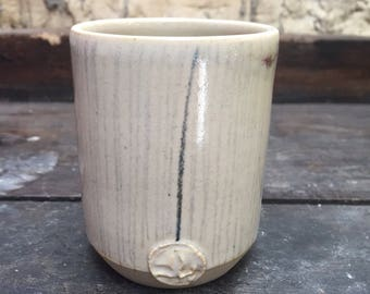 Cup turned stoneware, decoration in pencil of oxides