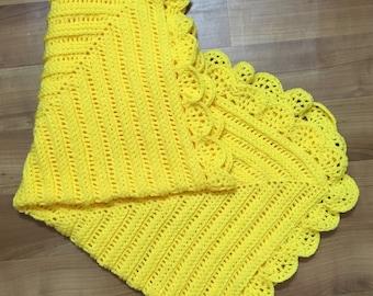 Crocheted bright yellow baby blanket