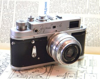 Zorki 4 Camera. Soviet Leica Copy. Camera with lens Industar 50.Soviet Retro Camera Old Fashioned Camera Used Lenses Antique Cameras
