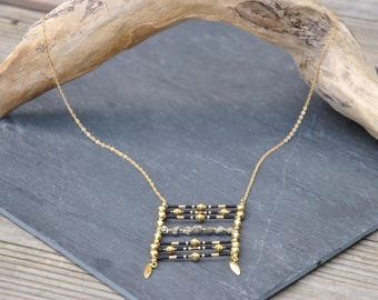 Long necklace in brass with small pyrite and miyuki beads