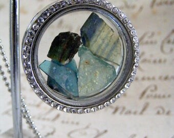 2000 year old Roman glass pieces set in a silvertone memory locket