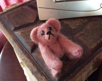 Pastel pink sitting bear , needle felted using pure wool , his little paws have tartan felt again needle felted on for extra character