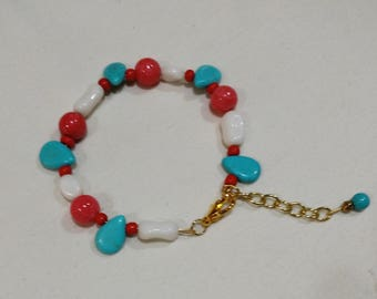 Striking red white and blue hand crafted turquoise bracelet with extender. Glass beads