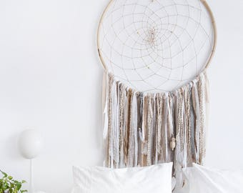 DreamCatcher XL, hand-woven, hand-made, to hang on the wall, various fabrics, beads of natural wood, feathers, bamboo.