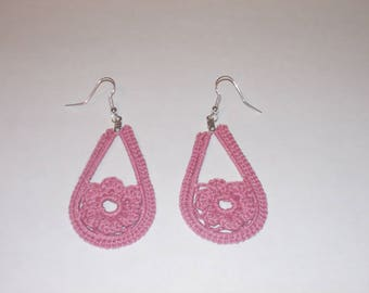 Handmade crochet teardrop earrings in dusty rose with a flower.