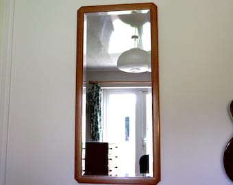 Bevelled Italian wall mirror with unusual wooden frame. Rare vintage item. Excellent condition.
