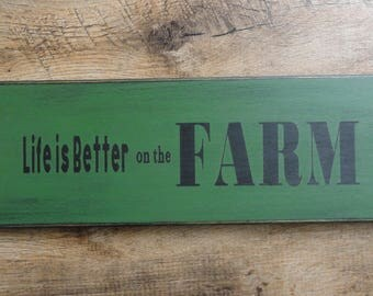 "Painted wood sign: ""Life is better on the farm"""