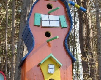 Add colour to your garden. Whimsical birdhouse