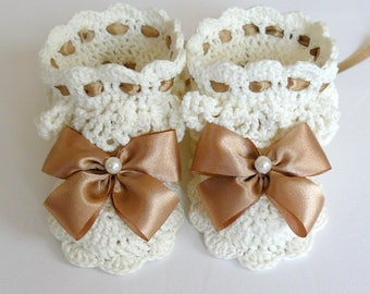 White lace crochet baby booties for girls.