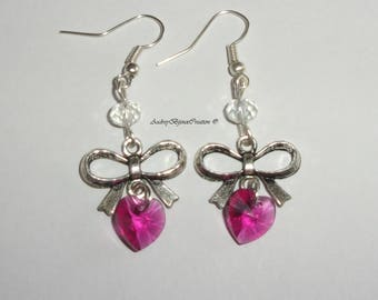 Node and fuchsia swarovski crystal heart earrings.