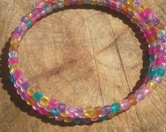 Boho hippy bracelet.  plastic beads. 8 inch. Memory wire.