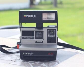 Vintage Polaroid Sun600 Camera Polaroid, Vintage, Camera, Vintage camera Photo photography, Retro, snapshot