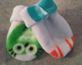 Baby fleece thumbless double layered mittens.